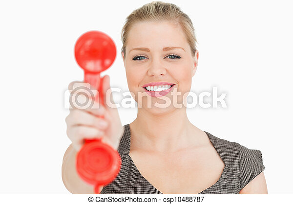 Retro phone red in a hand of a pretty woman - csp10488787