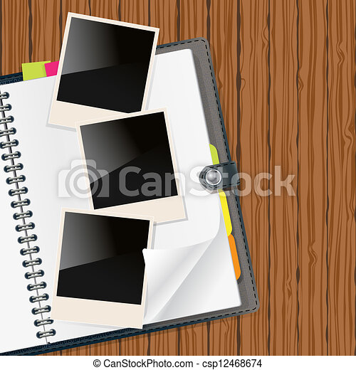 retro photo frames on open diary - csp12468674