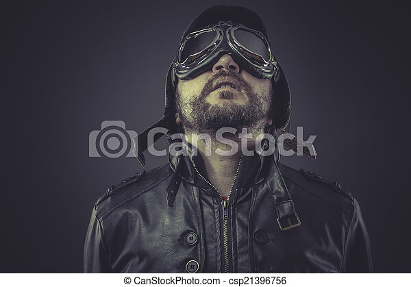 retro pilot dressed in vintage style leather cap and goggles - csp21396756