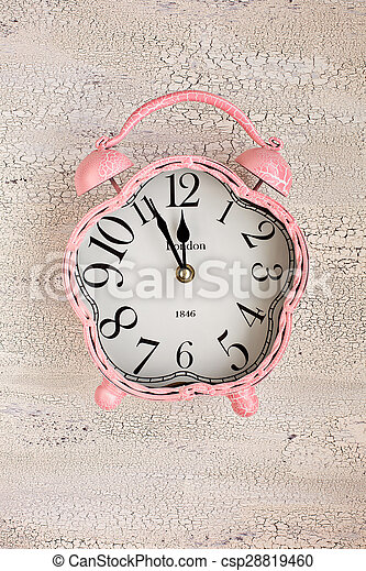 Retro pink clock on wooden background, top view - csp28819460