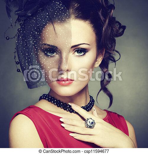 Retro portrait of a beautiful woman. Vintage style - csp11594677