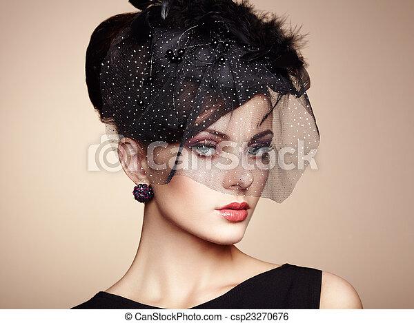 Retro portrait of a beautiful woman. Vintage style - csp23270676