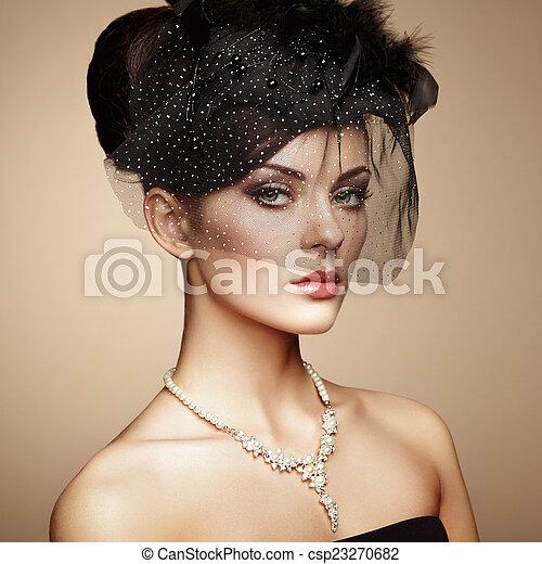 Retro portrait of a beautiful woman. Vintage style - csp23270682