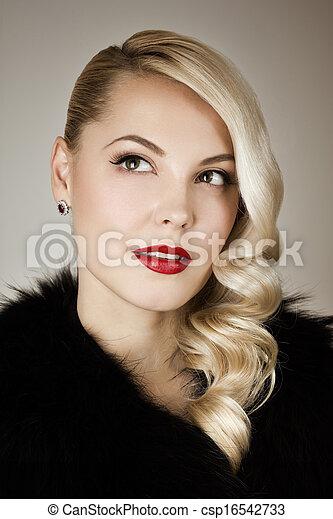 Retro portrait of a beautiful woman - csp16542733