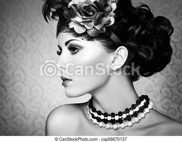 Retro portrait of a beautiful woman. Vintage style - csp56670137