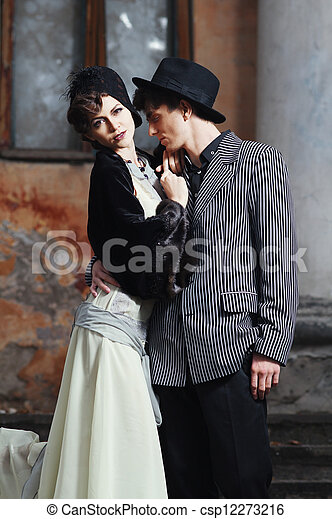 Retro styled fashion portrait of a young couple.  - csp12273216