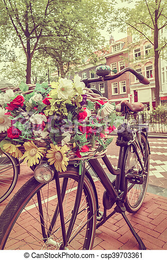 Retro styled image of a Dutch bicycle in Amsterdam - csp39703361