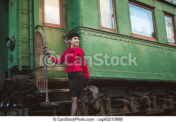 Retro woman on the train station - csp63210998