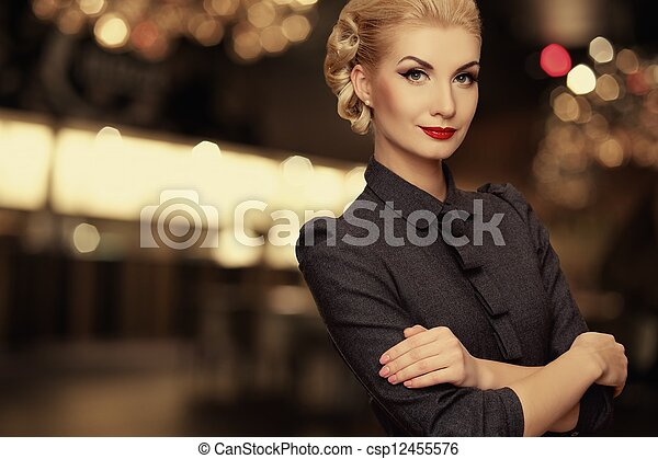 Retro woman over blurred background - csp12455576