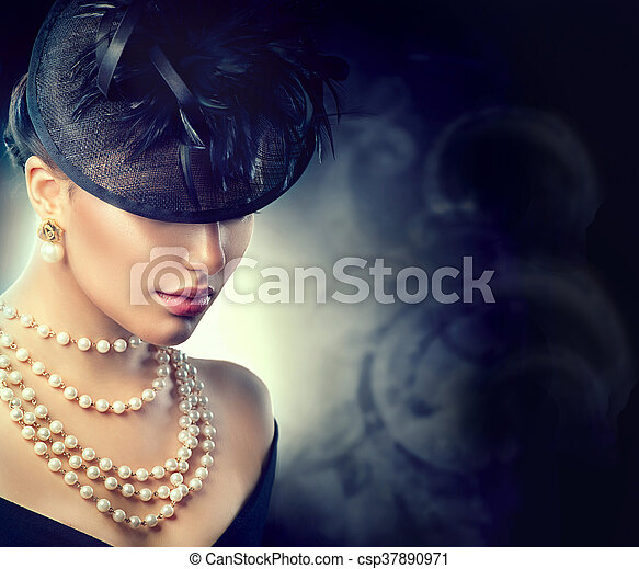 Retro woman portrait. Vintage style woman wearing old fashioned hat - csp37890971