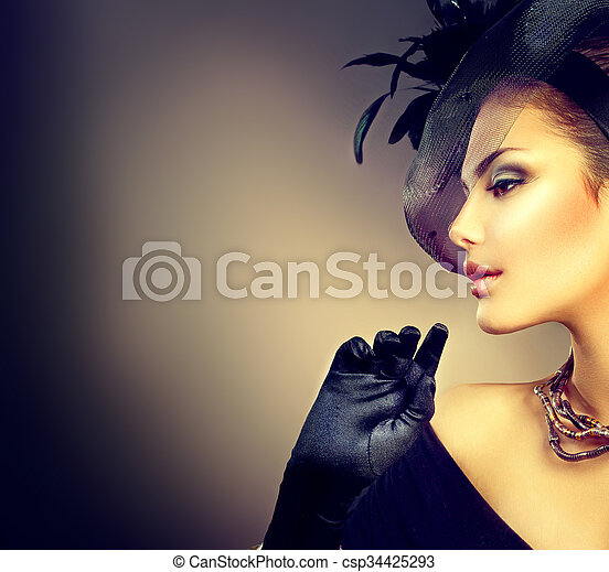 Retro woman portrait. Vintage style woman wearing hat and gloves - csp34425293