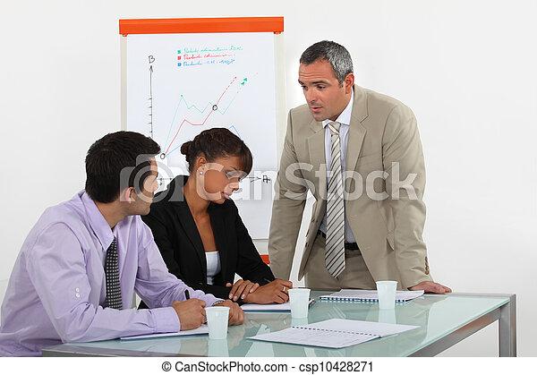 Equipo de negocios en una reunión - csp10428271