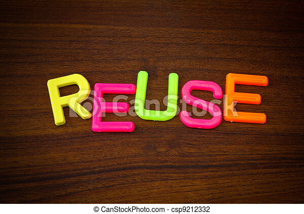 Reuse in colorful toy letters on wood background - csp9212332