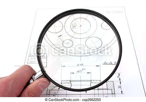 Reviewing technical drawing with magnifying glass. Focus on magnifying glass. - csp2662250