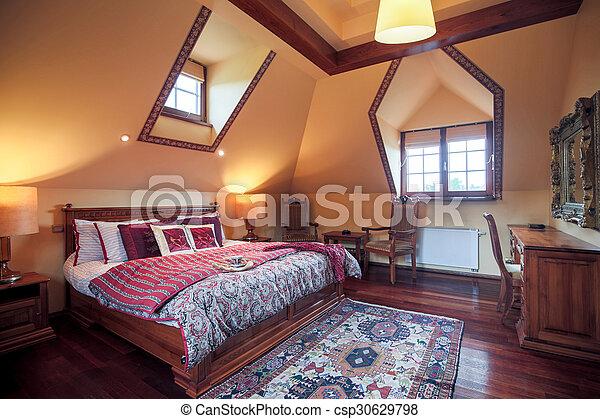 Dormitorio con cama tamaño rey - csp30629798