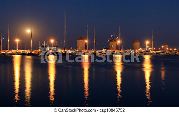 Rhodes harbor and windmills in Greece at sunset - csp10845752