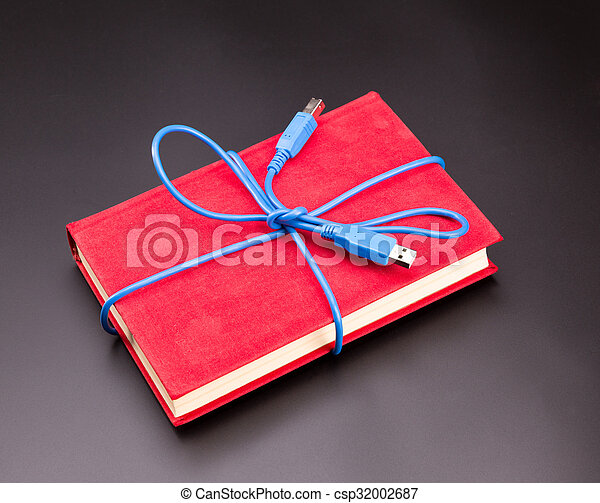 Ribbon from the usb cable on book as a present - csp32002687