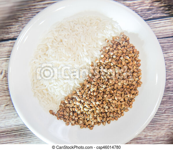 Rice and buckwheat one on a white plate - csp46014780
