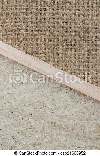 rice on sackcloth - csp21666952