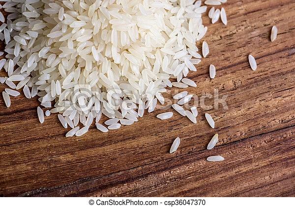 Rice on wood background - csp36047370
