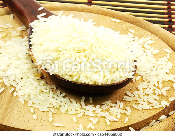 rice on wooden ladle close up - csp44659862