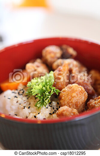 rice with fried chicken - csp18012295
