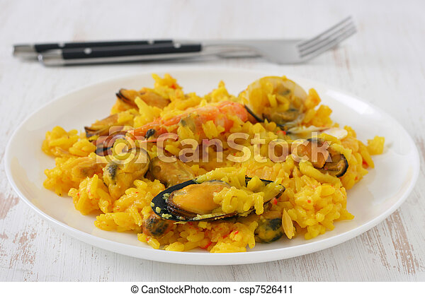 Rice with seafood on a plate - csp7526411