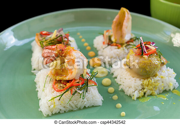 Rice with Seafood on black background. - csp44342542