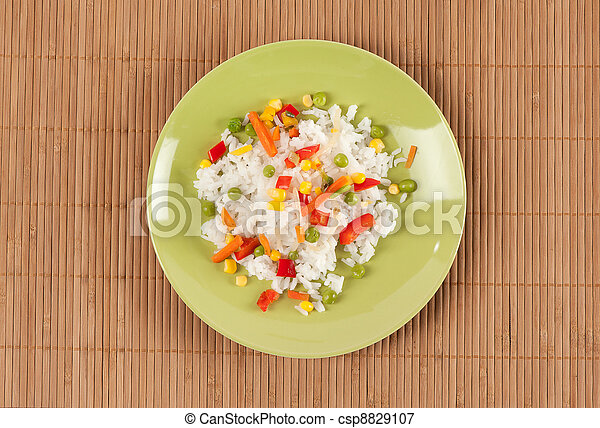 rice with vegetables on a plate - csp8829107