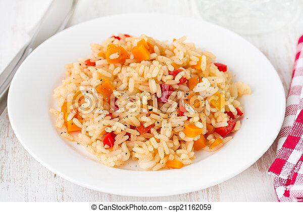 rice with vegetables on white plate - csp21162059