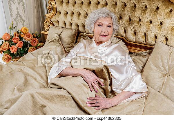 Rich Senior Lady Relaxing In Bedroom Elegant Old Woman Is Lying