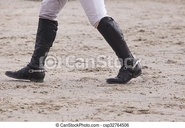 Rider walking a course - csp32764506
