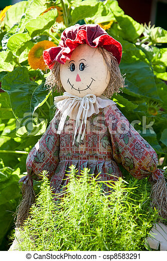 ridiculous rag scarecrow costs in a kitchen garden for scaring away of birds - csp8583291