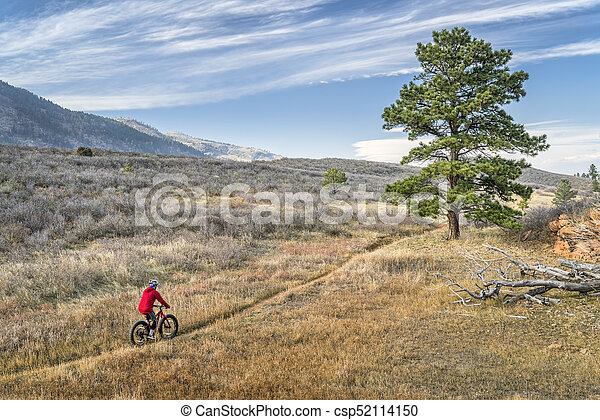riding a fat bike in Colorado foothills - csp52114150
