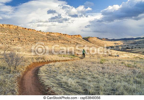 riding fat bike in Colorado foothills - csp53849356