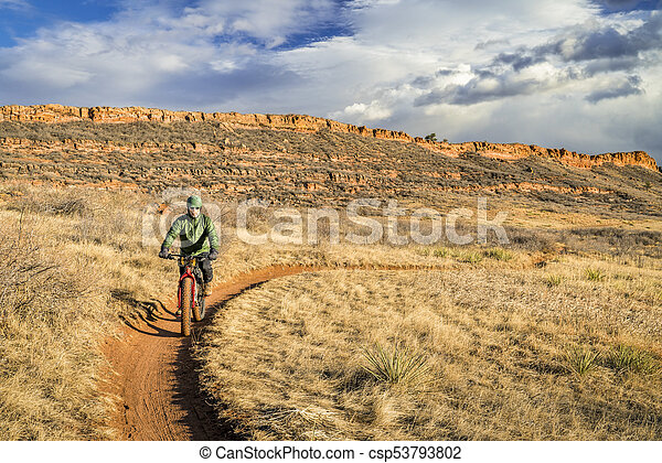 riding fat bike in Colorado foothills - csp53793802