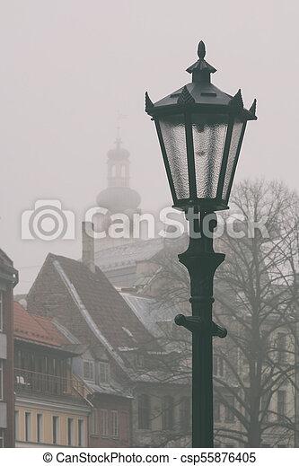 Riga City Lantern in the Fog - csp55876405