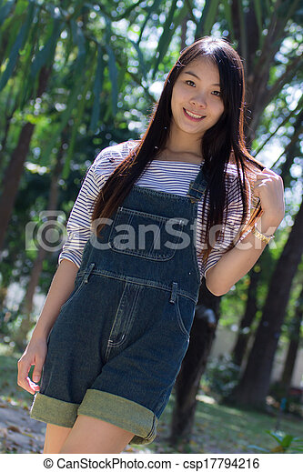Rimight Portrait Beautiful asian woman in Park - csp17794216