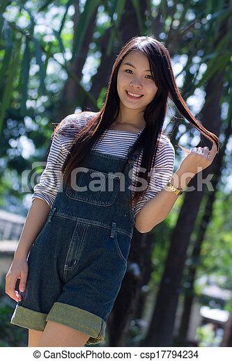 Rimight Portrait Beautiful asian woman in Park - csp17794234