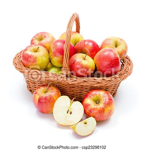 Ripe apples in basket - csp23298102