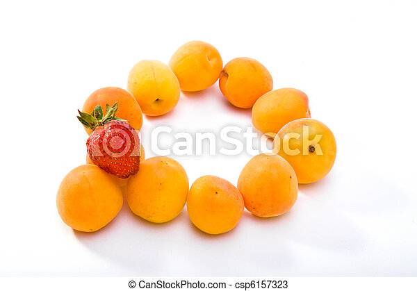 Ripe apricots and berry of strawberry on white background - csp6157323