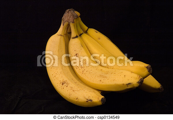 Ripe Bananas on a Black Background - csp0134549