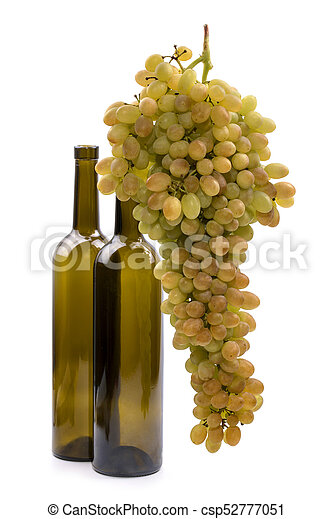 Ripe big bunch of grapes of sultana on white background with two bottles - csp52777051