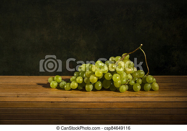 Ripe big bunch of grapes of sultana - csp84649116
