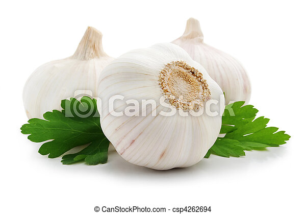ripe garlic fruits with green parsley leaves - csp4262694