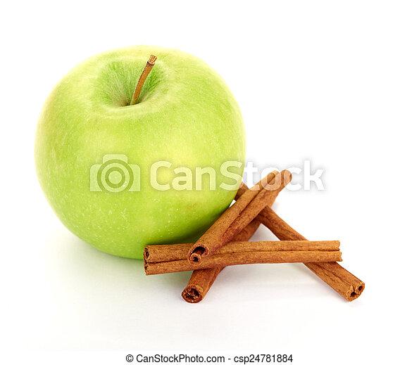 Ripe green apple with cinnamon sticks - csp24781884