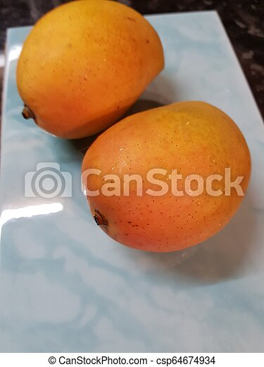 Ripe mangoes - csp64674934