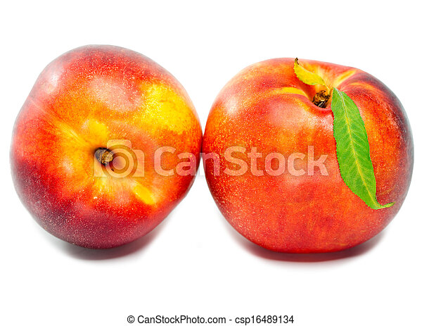 Ripe nectarine with a green leaf on a white background - csp16489134