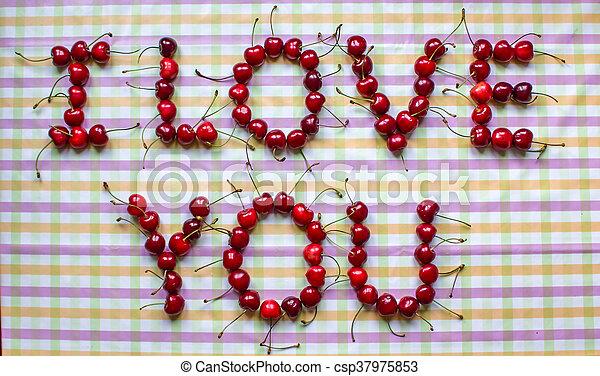 Ripe organic homegrown cherries , I love you text - csp37975853