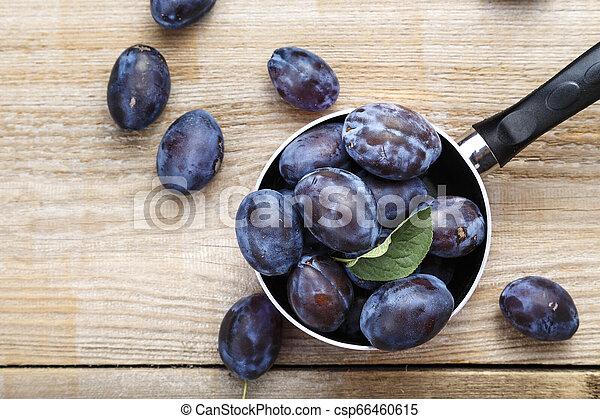 ripe plums harvest - csp66460615